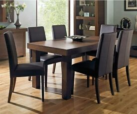 Bentley Designs Table With 6 Taper Back Brown Faux Leather Upholstered Chairs