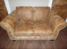 DFS 2 seater sofa. Savoy range in ranch. 100% leather. FEW MONTHS OLD.