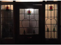 Original 1930's door with coloured glass and side windows.