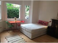 Fantastic large, bright and sunny self contained studio available now! Free WIFI!