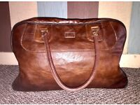 Brown faux leather hand luggage