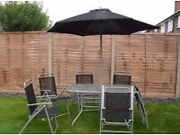 Garden Table with Six Foldable Chairs and Parasol