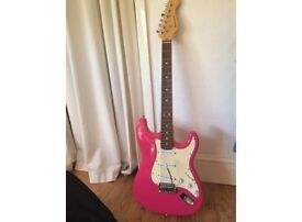 Pink electric guitar with amplifier and case - very good condition