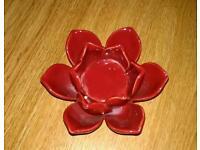 Lovely red tea light holder. Very stylish good LOOK