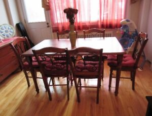 Dining table with four chairs. Real wood