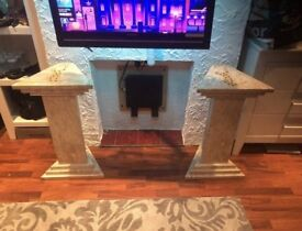2 Brazilian marble columns with a leopard insert on top.