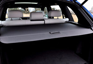 Retractable black cargo cover for a BMW X5.