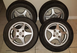 Nissan mags (4x114.3) with 195/60/14 Evertrek summer tires
