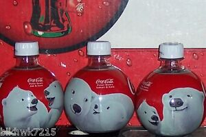 2013 COCA COLA ARTIC LIFE POLAR BEAR ROUND ORNAMENTS 13.5 OZ HARD PLASTIC BOTTLE