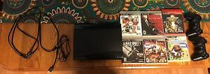 PS3 with 2 controllers 6 games and all cords