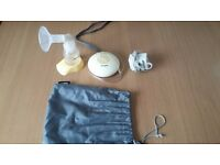 Medela Swing breast pump with many accessories and extras