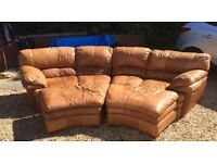 Large leather 4/5 seater curved sofa with foot stools
