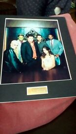 a lovely mounted photograph of the Cast Of Angel