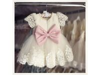 Flower girl dress with matching hairpiece. Brand new tags attached. Age 3.