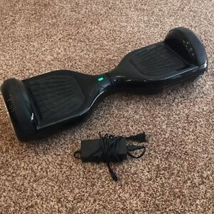 Black hoverboard, used very good. 200$
