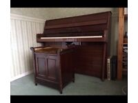 B. Squire upright piano with free stool
