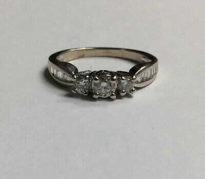 Ladies 14KT White Gold 3 Stone Diamond Ring .70CTTW