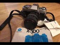 Minolta X300 camera with 28mm-70mm lens and Lowepro camera bag