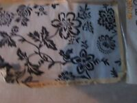 LARGE WHITE WITH BLACK PATTERNED RUG BRAND NEW IN THE PACKET 48 inch x 70 inch or 4ft x 6ft aprpox