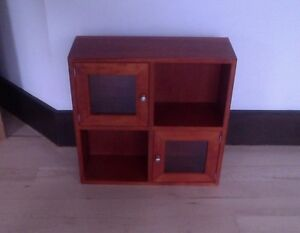 Small wall-mounted shelf with doors