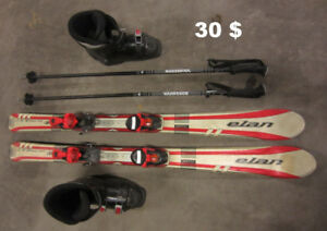 30$ - ski, poles and boots for kid size 5 or 6
