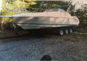 1996 Rinker Boat with new tri axel trailer