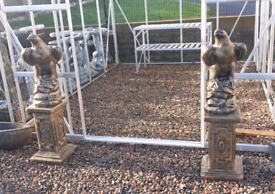 Stone Eagle Garden ornaments on tall base urns