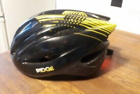 CYCLING HELMET WITH REAR LIGHT £10