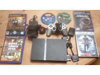 Sony PS2 Slimline version with 6 games & 1 console