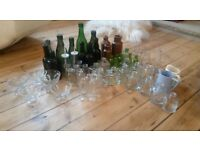 Job lot green/clear glass bottles - 56 items. Vintage/rustic, event or wedding table decorations