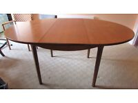 Wooden Dining Room Table - Round which extends to an oval - FREE - Collection from Blandford Forum