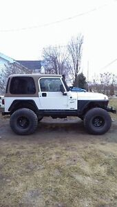 1999 Jeep Wrangler tj for trade for a trailer home try your trad