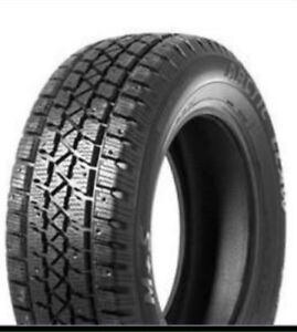 4 Arctic claw winter tires 235 75 15 new