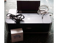 Canon Pixma IP4300 colour inkjet printer, with extra ink cartridges