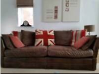 Two large leather and fabric sofas. One 3 seater, one two seater