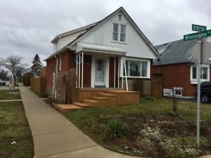 Large corner lot home with two plus one bedroom