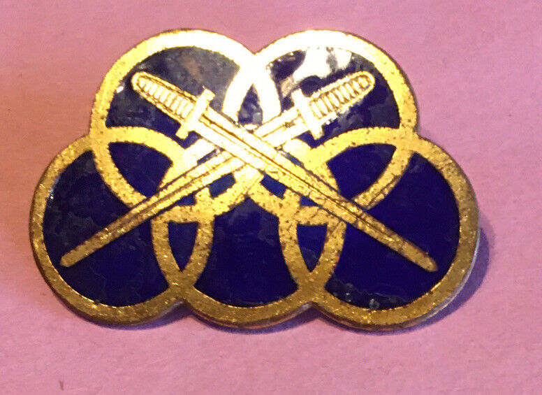 unknown early 20th century,Olympic style with Crossed Swords, pin-back  badge