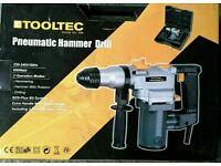 Pneumatic hammer drill
