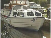 Cabin cruiser / Fishing boat with 50hp outboard and trailer