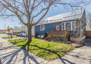 House with versatile light industrial zoning on big lot!