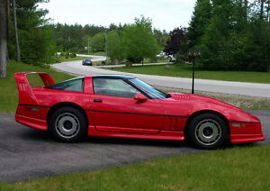 1985 Red Corvette with ground effects aerodynamic spoiler kit