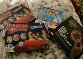 4 x brand new board games / christmas games inc. Pie Face Cannon x 2