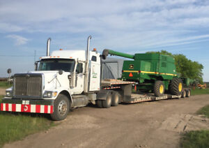 Combine hauling & Air Drill towing.