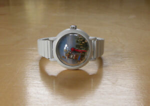 "vintage ""out of time"" watch with floating action figure"
