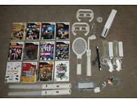 Nintendo Wii, Balance Board, 12 games, 2 controllers + nunchuk, other extras