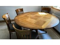 Bargain solid oak dining table and 6 chairs