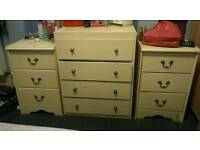 Cream wooden chest of drawers and two bedside tables