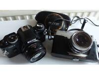 Two film cameras.