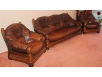 Leather three-piece suite with matching footstool (all with wooden frames)