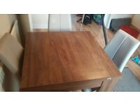 Next extendable table and 4 faux leather chairs